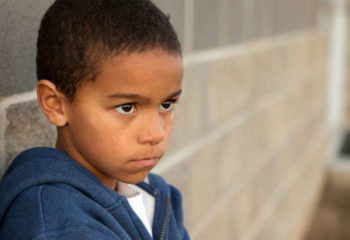 Angry little boy in an urban setting.